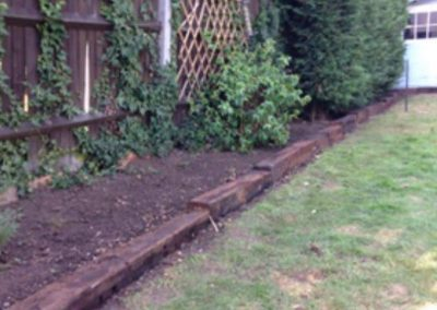 Old style railway sleepers laid for borders